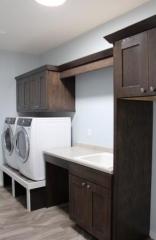 Raised laundry machines